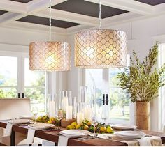 Capiz Drum Pendant | Pottery Barn This is super cool 2 pendants.But I think even one would be beautiful.