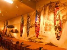 Whole Foods wall with my 2 silver and black surfboards.