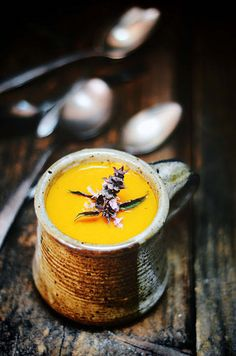 This vibrant Carrot and Rhubarb Soup is an example of the ease which comes from growing your own produce. Root vegetables and rhubarb produce a mug of warming soup. Nik Sharma of {a brown table} garnishes the soup with purple basil.    @abrowntable