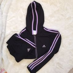 Vintage Adidas Tracksuit Classic vintage Adidas tracksuit with on trend black and lilac contrasting colors and a cropped fit perfect for spring. Both pieces are size S. Jacket is a classic fit, pants are cropped.  In excellent vintage condition. A bit of chipping of the paint on the zipper, but otherwise no flaws or signs of wear to note. Selling as a set only! Adidas Tops Sweatshirts & Hoodies