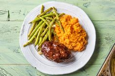 No matter which way you try to dress it up, a meatloaf is all about the meat. Which is why we're adding little more than a few breadcrumbs to keep it moist and a smattering of balsamic ketchup glaze to keep things interesting. That's all you really need (along with some green beans and mashed sweet potato) to emphasize the classic timelessness of this dish.