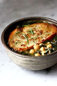 Kale, chickpea and Chicken soup with a toasty Rosemary crouton. Brothy, healing and delicious! | www. feastingathome.com