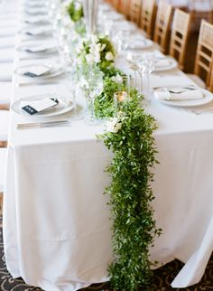 Lovely, green table runner garland. Looks so fresh with all the white.
