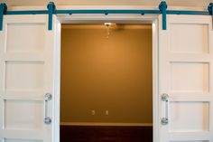 Barn doors with turquoise track and pipe handles