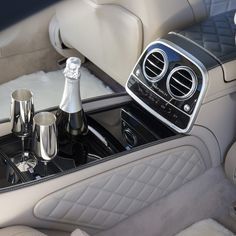 Passengers in the back may enjoy chilled beverages from the rear seat refrigerator. A set of champagne flutes come standard.  Mercedes Benz S600 Maybach