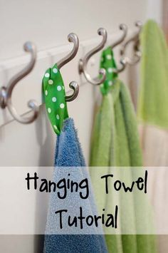 hang towels in our bathrooms with little piece of ribbon