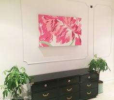 Using artwork to hide a tv and use O'verlays Anne as an easy diy border.  Millwork without the difficulty or cost.
