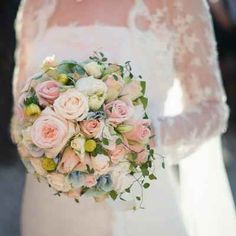 Bride's Lovely Round Wedding Bouquet Featuring Pastel Roses
