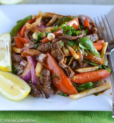 Lomo Saltado(Peruvian Stir Fry) - Used what I had on hand including substituting 1 can of diced fire roasted salsa style tomatoes instead of fresh tomatoes. Added 1 cup of brown gravy as well towards the end. Thin Aldi brand fries were perfect for this.  - Jen K