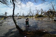 Two young boys stand in Tacloban City, Leyte, Philippines, looking at the devastation caused by Typhoon Haiyan. Photo: Dondi Tawatao/Getty