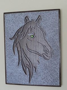 Horse. The size is 12 x 10 I used the best quality of wood, nails and silk treads. Perfect for gifts. Can be hung on the wall. I can make it just for you: different sizes and colors.
