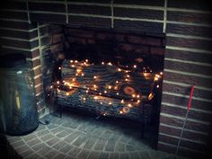Add a string or two of twinkle lights in the fireplace to add a soft glow to the room. I put lights in my fireplace instead of turning on the gas. Since the price of gas went up it saves money.