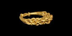 VIKING GOLD PLAITED RING 9th-11th century AD A round-section hoop formed from tightly-plaited gold rods, the underside closed by twisting the ends to the shank forming a knot. 12 grams, 26.64mm overall, 20.88mm internal diameter