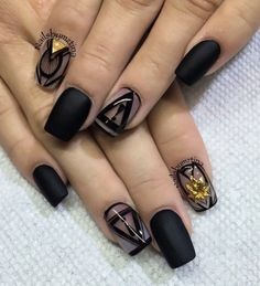 Matte black and tribal inspired nail art. Cover your nails in bold matte black polish and add tribal designs as well as small French tip for an added dramatic effect.