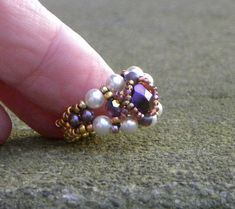 Designed by me! One of my favorite rings. Still wear this one in the photo. Tutorial available.