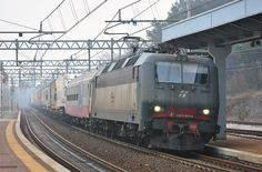 Italy - Class E405.004 of Trenitalia Cargo hauls a RoLa train from Tarvisio Boscoverde to Trieste Campo Marzio. Here the convoy passes from Monfalcone station – by atropo8 – 12 february 2011 - more info (in French) at  http://mediarail.be/UE_TRAXX/Traxx_06_Eco2000.htm