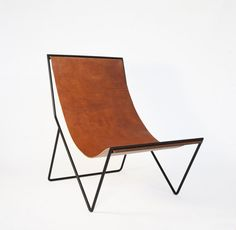 "Is Belgian designer Michael Verheyden's G55 leather sling lounger the ""it"" chair of the moment? We think so. Here it is, along with some strikingly similar"