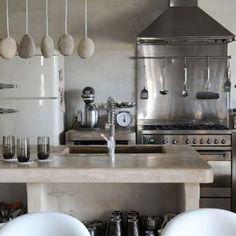 smeg fridge, stone benches, stainless steel, organic little hanging things - hello!
