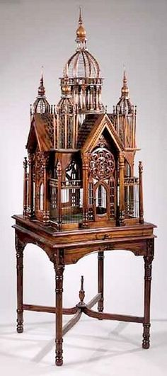 Carved mahogany Cathedral birdcage on matching stand