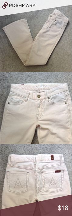 7FAM A Pocket Light Corduroy Pants 24 These pants are a thin corduroy material. The color is cream, but in certain lights can look a very light pink. These are called A pocket pants because of the design on the back pocket. These are in good condition with two very tiny, light stains on one leg. The fabric has minimal wear. Inseam 29.5in 7 For All Mankind Jeans Flare & Wide Leg