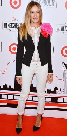 Sarah Jessica Parker's 50 Most Memorable Looks Ever | a casual take on the menswear trend, opting for a classic black fitted blazer and white cropped pants for Target's Toronto opening, 2013