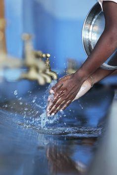 Schoolchildren washing their hands in clean water in India.