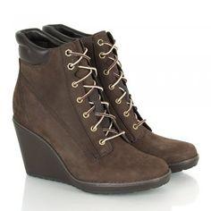 The Timberland Women's Earthkeepers Meriden 6 inch Boot combines a hiking  design with feminine wedge heel