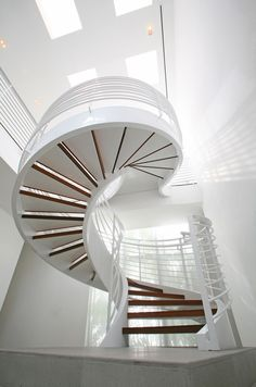 Atrium staircase at the Belvedere House in Miami Beach designed by Shulman + Associates