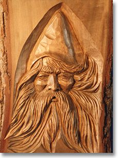 Wizard or Woodspirit or Spirit Face Inlay in a Log by Peter Newton (Idea to do this inlay)