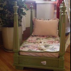 Four poster toddler bed!  Amazing, just take an old table and spruce it up a bit, turn it upside down, add a matress, pillows and bedding and you've got a gorgeous four poster bed! You could also add mosquito netting draping to complete the look or make it a toddler day bed.