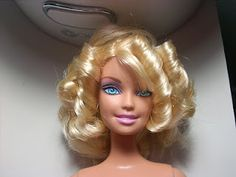 How to curl Barbie hair- great for fixing the various Disney Princess doll's hair!
