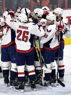 The Washington Capitals celebrate after advancing to