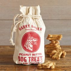 PEANUT BUTTER DOG TREATS -- You know your dog likes PB just as much as you do, so treat him (or her) to these healthy dog biscuits, baked in the USA with all-natural ingredients, including vitamin E. Packaged in a drawstring cotton sack, just for fun. 12 oz.