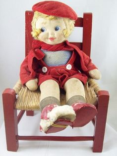 100 yr. old Campbell soup doll & chair