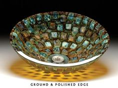 """Alchemy Mosaic glass sink with """"pillows"""" of glass embedded into the surface. Color palette reflects back blues and greens but lets through amber and gold."""