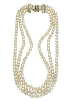 The property of a Royal family. A three-strand natural pearl and diamond necklace.