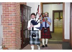 Piping in of the haggis, McLean Albritton and Dr. Tom Perrin.