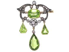 Antique Victorian Peridot and Diamond Brooch in Silver and Gold. Diamond total weight is 0.50 carats and peridot total weight is 5.0 carats. Circa 1880