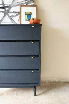How To Refurbish Old Furniture: Mid-Century Dresser Makeover | Scratched wood and used furniture is no match for a simple diy upgrade. New paint, sanding and new hardware works to makeover craigslist furniture fast. See the full tutorial here.