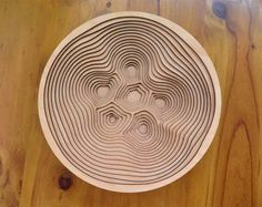 Laser Cut plywood assembled to create a contour bowl.