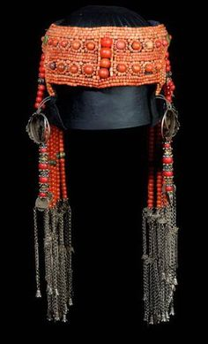 """""""Although we (Truus and Joost Daalder) don't have the most grandiose form of Mongolian headdresses, we do have more than one decent one, and this is one of them. The image shows the front of a piece from *Ethnic Jewellery and Adornment*, p. 279. The main beads are a mixture of Chinese - so-called """"Peking"""" - glass and coral. Early 20th c."""" Joost Daalder"""