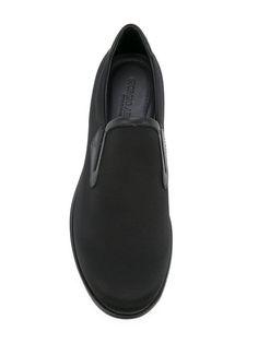 Shop Giorgio Armani slip-on sneakers.