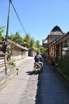 #streetoftheday #Bali, #Indonesia. Note decorative street surface and thatch roof architecture.