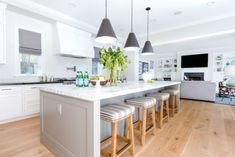 Modern Farmhouse bright white kitchen with a carrara marble oversized island. The gray on the island is Galveston Gray by Benjamin Moore Project Newport Harbor - Blackband Design Kitchen Cabinets Grey And White, Light Grey Kitchens, Grey Kitchen Island, Farmhouse Kitchen Island, Kitchen Island Lighting, Modern Farmhouse Kitchens, Home Kitchens, Farmhouse Ideas, Kitchen Family Rooms