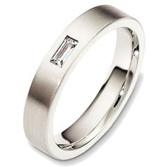 Platinum diamond, comfort fit, 4.0mm wide wedding band. The ring holds one straight baguette cut diamond that is 0.15 ct, VS1-2 in clarity and G-H in color. The ring has a matte finish. Different finishes may be selected.