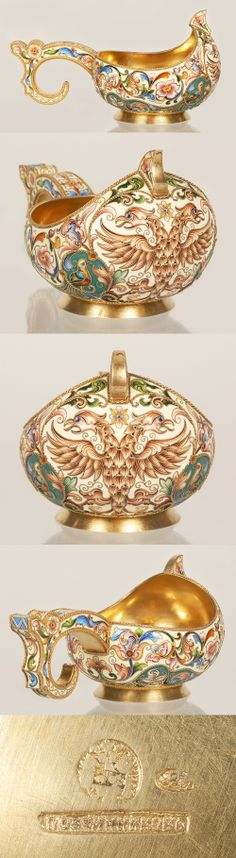 An amazing and extremely rare Russian gilded siver and shaded cloisonne enamel kovsh by Feodor Ruckert, Moscow, circa 1896-1908. Of traditional oval form with hook handle, the front emblazoned with an ornate Imperial Eagle with a bird on either side, wrapped with scrolling florals against a seafoam green grounds.