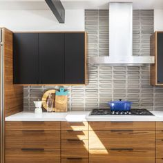 The Mid-Century California Home Fueling Our Tile Obsession #SOdomino #room #interiordesign #furniture #property #countertop #cabinetry #kitchen #tile #turquoise #hardwood