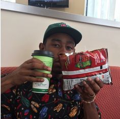 Tyler, the creator on the hood combo! Chili cheese on nacho cheese doritos…