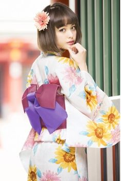Yukata are light weight cotton summer kimono. They can be easily turned into summer dresses by either removing or altering the sleeves and/or raising the hemline