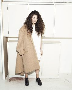 New Zealand singer Lorde wearing a cashmere coat from Eugénie Collection 1 in Rolling Stone.